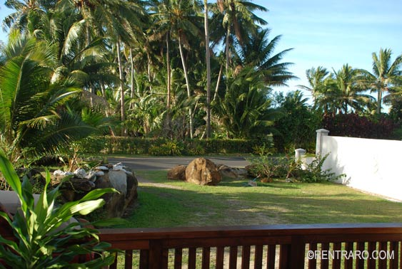 view of the tropical front yard from the veranda at Aito Apartments Rent, Rarotonga Cook Islands