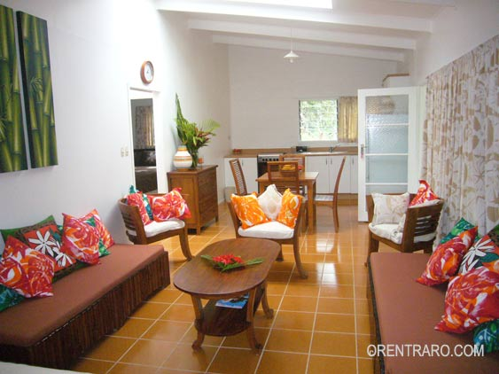 cosy living area with kitchen in the background at Lyas Holiday Rental, Rarotonga, Cook Islands