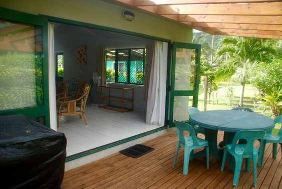 Sliding doors from the lounge lead to the wooden deck