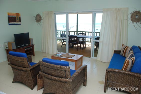 spacious living area with comfortable seating an TV and stereo