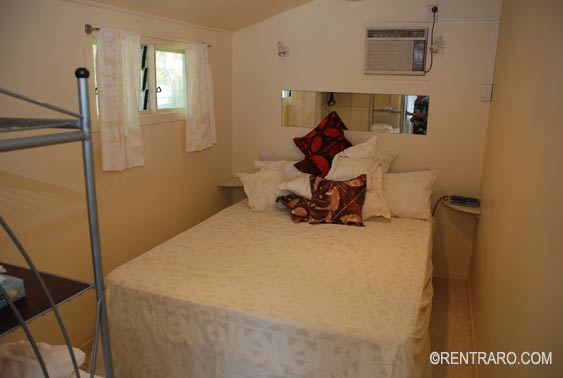 A cosy petite bedroom at the back of the house at Muri Lagoon Villa