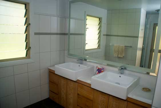 the large bathroom and shower area