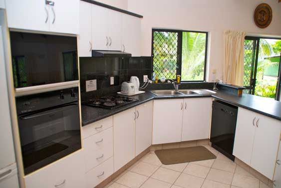 modern kitchen with fridge, freezer, dishwasher, microwave, coffee-maker and water cooler.