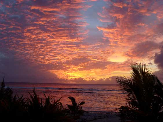 stunning red sunset, taken from the veranda at Aromas, Rarotonga, Cook Islands