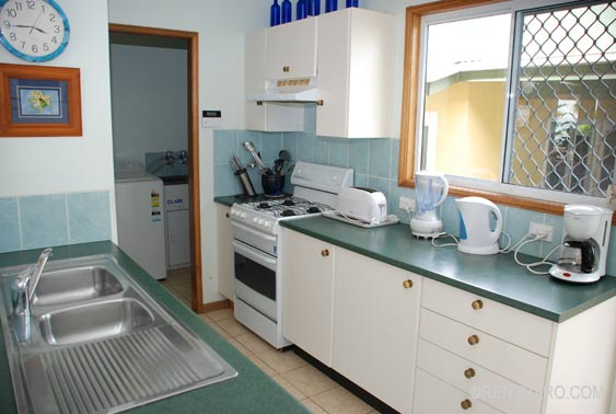 modern kitchen with full stove, dishwasher, fridge/freezer, microwave, coffee maker is well stocked with all the kitchenware
