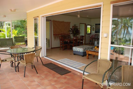 a wide shady wraparound veranda with massive sliding doors