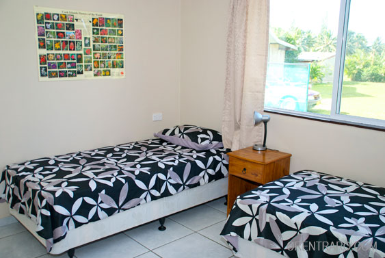 the second bedroom has two singles at Kia Manuia, Rarotonga, Cook Islands