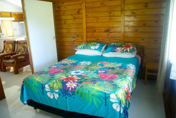 master bedroom with queen size bed at MAcs Shack