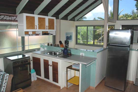 The kitchen area has a full stove, microwave, fridge/freezer and telephone