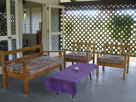 Shady verandah on two sides of the house surrounded by trellis for privacy