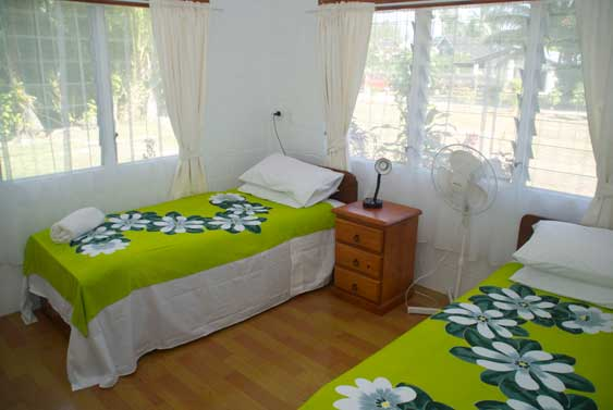 fouth bedroom with two single beds at Muri Beach Haven in Muri