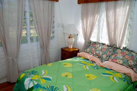 third bedroom at Muri Beach Haven, with queen size bed and tivaevae quilt